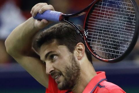 Gilles Simon of France wipes sweat during the men's singles quarterfinals match against Jack Sock of the United States in the Shanghai Masters tennis tournament at Qizhong Forest Sports City Tennis Center in Shanghai, China, Friday, Oct. 14, 2016. (AP Photo/Andy Wong)