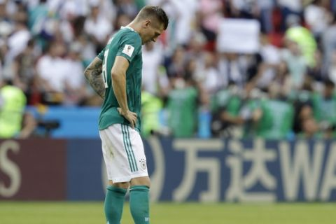 Germany's Toni Kroos looks dejected after Germany was eliminated during the group F match between South Korea and Germany, at the 2018 soccer World Cup in the Kazan Arena in Kazan, Russia, Wednesday, June 27, 2018. (AP Photo/Michael Probst)