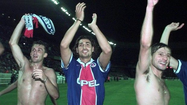 Paris St Germain's players (left to right) Franck Gava, Eric Rabesandratana and Leonardo Nascimento, of Brazil waves to the crowd after their team defeated  Steaua Bucharest during their second-leg second-round Champion Cup qualifier match, at the Parc des Princes stadium in Paris, Wednesday August 27, 1997.  Paris St Germain won 5-0 and is qualified for the Champions League.(AP  Photo/Laurent Rebours)