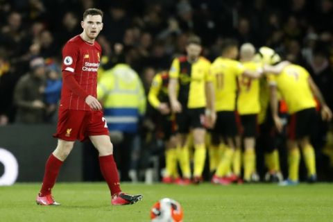 Liverpool's Andrew Robertson reacts after Watford's Troy Deeney scores his side's third goal during the English Premier League soccer match between Watford and Liverpool at Vicarage Road stadium, in Watford, England, Saturday, Feb. 29, 2020. (AP Photo/Alastair Grant)