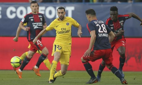 Javier Pastore of Paris Saint Germain controls the ball against Damien Da Silva of Caen during their League One soccer match at the Michel d'Ornano stadium in Caen, western France, Saturday, May 19, 2018. This is his last match with the PSG team. German coach Thomas Tuchel will replace him for the next season. (AP Photo/David Vincent)