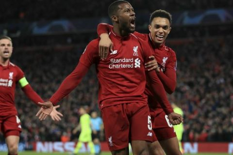 Liverpool's Georginio Wijnaldum celebrates scoring his side's third goal of the game during the Champions League Semi Final, second leg soccer match between Liverpool and Barcelona at Anfield, Liverpool, England, Tuesday, May 7, 2019. (Peter Byrne/PA via AP)