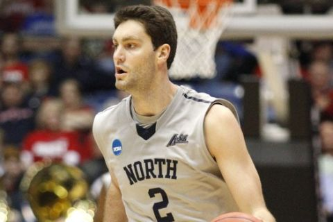 North Florida's Beau Beech (2) brings the ball up against Robert Morris in the second half of a first round NCAA tournament basketball game Wednesday, March 18, 2015, in Dayton, Ohio. (AP Photo/Skip Peterson)
