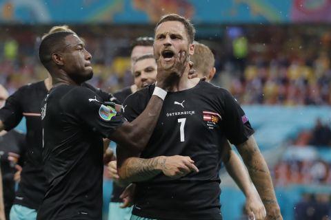 Ο Μάρκο Αρναούτοβιτς πανηγυρίζει γκολ του στο Αυστρία - Βόρεια Μακεδονία για το Euro 2020.