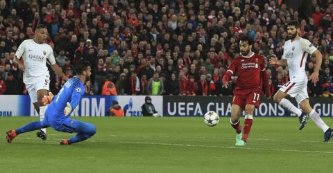 Liverpool's Mohamed Salah scores his side's second goal of the game against Roma during their Champions League, Semifinal first leg soccer match at Anfield, Liverpool, England, Tuesday April 24, 2018. (Peter Byrne/PA via AP)