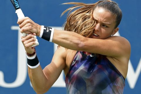 Maria Sakkari, of Greece, returns a shot from Kiki Bertens, of Netherlands, during the first round of the U.S. Open tennis tournament, Monday, Aug. 28, 2017, in New York. (AP Photo/Michael Noble)