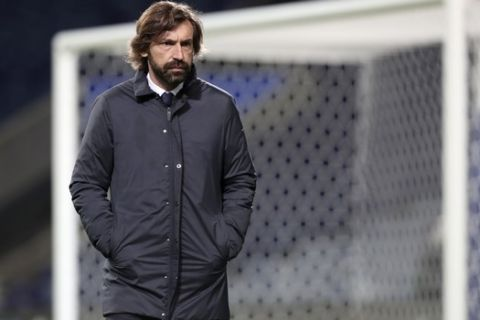 Juventus' head coach Andrea Pirlo stands on the pitch during warmup before the Champions League round of 16, first leg, soccer match between FC Porto and Juventus at the Dragao stadium in Porto, Portugal, Wednesday, Feb. 17, 2021. (AP Photo/Luis Vieira)
