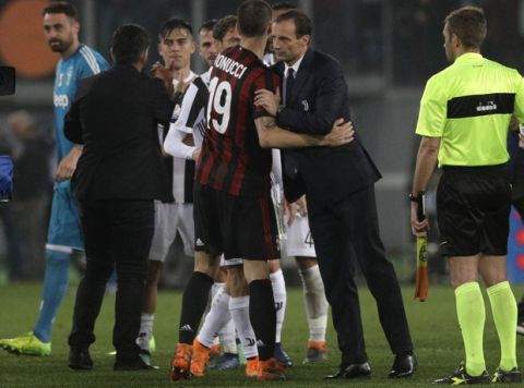 Juventus coach Massimiliano Allegri greets AC Milan's Leonardo Bonucci at the end of the Italian Cup final soccer match between Juventus and AC Milan, at the Rome Olympic stadium, Wednesday, May 9, 2018. (AP Photo/Gregorio Borgia)