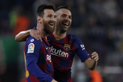 Barcelona's Lionel Messi celebrates his goal with Barcelona's Jordi Alba z during the Spanish La Liga soccer match between FC Barcelona and Valladolid CF at the Camp Nou stadium in Barcelona, Spain, Tuesday, Oct. 29, 2019. (AP Photo/Joan Monfort)