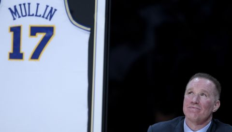 Former Golden State Warriors player  Chris Mullin is shown during a halftime ceremony to retire his jersey number at an NBA basketball game between the Golden State Warriors and the Minnesota Timberwolves in Oakland, Calif., Monday, March 19, 2012. (AP Photo/Jeff Chiu)