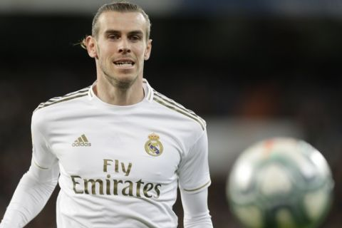 Real Madrid's Gareth Bale controls the ball during a Spanish La Liga soccer match between Real Madrid and Athletic Bilbao at the Santiago Bernabeu stadium in Madrid, Spain, Sunday Dec. 22, 2019. (AP Photo/Paul White)