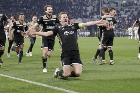 Ajax players celebrate at the end of the Champions League, quarterfinal, second leg soccer match between Juventus and Ajax, at the Allianz stadium in Turin, Italy, Tuesday, April 16, 2019. Ajax won 2-1 and advances to the semifinal on a 3-2 aggregate. (AP Photo/Luca Bruno)