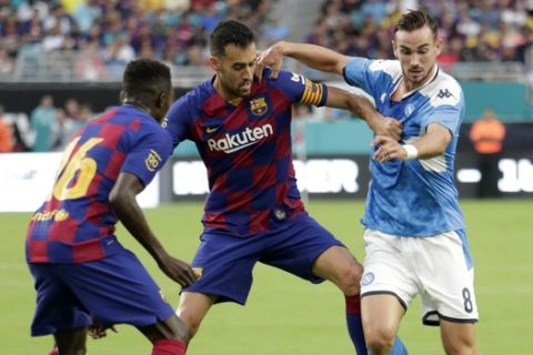 Napoli midfielder Fabian Ruiz (8) controls the ball as Barcelona midfielder Sergio Busquets, center, defends during the first half of a LaLiga-Serie A Cup soccer match, Wednesday, Aug. 7, 2019, in Miami Gardens, Fla. (AP Photo/Lynne Sladky)