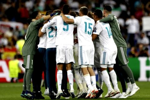 Real Madrid players celebrate after wining the Champions League Final soccer match between Real Madrid and Liverpool at the Olimpiyskiy Stadium in Kiev, Ukraine, Saturday, May 26, 2018. (AP Photo/Matthias Schrader)