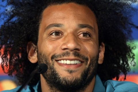 Real Madrid's Marcelo smiles during a press conference at the Olympic stadium in Kiev, Ukraine, Friday, May 25, 2018 ahead of the Champions League final soccer match between Real Madrid and Liverpool on Saturday May 26. (UEFA Pool via AP)