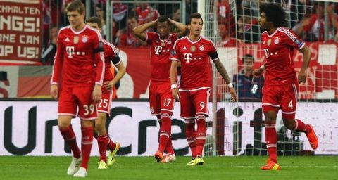 MUNICH, GERMANY - APRIL 29:  Toni Kroos (39), Jerome Boateng (17), Mario Mandzukic (9) and Dante of Bayern Muenchen (4) look dejected as Sergio Ramos of Real Madrid scores their second goal during the UEFA Champions League semi-final second leg match between FC Bayern Muenchen and Real Madrid at Allianz Arena on April 29, 2014 in Munich, Germany.  (Photo by Martin Rose/Bongarts/Getty Images)