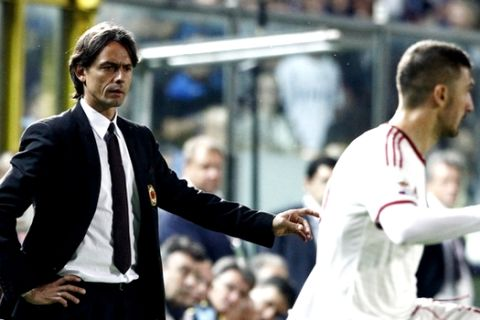 AC Milan's coach Filippo Inzaghi, left, gestures during a Serie A soccer match between Atalanta and AC Milan in Bergamo, Italy, Saturday, May 30, 2015. (AP Photo/Felice Calabro')
