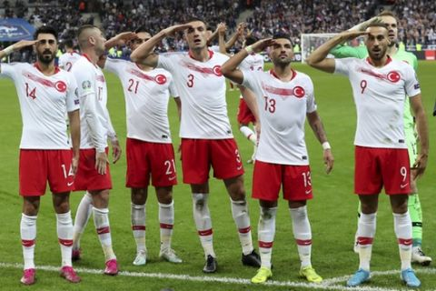 Turkey's players salute as they celebrated a goal against France during the Euro 2020 group H qualifying soccer match between France and Turkey at Stade de France at Saint Denis, north of Paris, France, Monday, Oct. 14, 2019. (AP Photo/Thibault Camus)