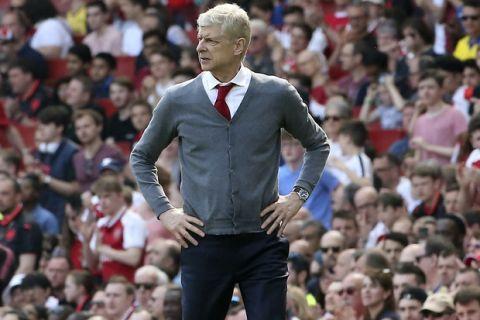 Arsenal's Arsene Wenger watches the English Premier League soccer match against West Ham United at the Emirates Stadium, London, Sunday April 22, 2018. (Mark Kerton/PA via AP)