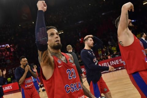 Moscow's Daniel Hackett, center, and Moscow's Nikita Kurbanov, right, celebrate their team's 95-90 win in the Euroleague Final Four semifinal basketball match between CSKA Moscow and Real Madrid at the Fernando Buesa Arena in Vitoria, Spain, Friday, May 17, 2019. (AP Photo/Alvaro Barrientos)