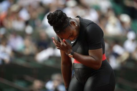 Serena Williams of the U.S. reacts after missing a return against Krystina Pliskova of the Czech Republic during their first round match of the French Open tennis tournament at the Roland Garros stadium in Paris, France, Tuesday, May 29, 2018. (AP Photo/Alessandra Tarantino)