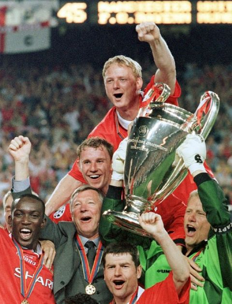 ** FILE ** Manchester United manager Alex Ferguson, 2nd left, celebrates with his players after winning the Champions League final soccer match at the Nou Camp Stadium in Barcelona, Spain in this Wednesday, May 26, 1999 file photo. Manchester United beat Bayern Munich 2-1. Ferguson celebrates 20 years in charge of Manchester United on Monday Nov. 6, 2006. (AP Photo/Cesar Rangel)
