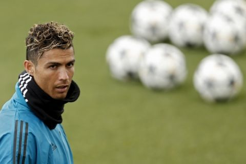 Real Madrid's Cristiano Ronaldo works out with teammates during a training session at the team's Valdebebas training ground in Madrid, Monday, April 30, 2018. Real Madrid will play a Champions League semi final second leg soccer match with Bayern Munich on Tuesday, May 1. (AP Photo/Francisco Seco)
