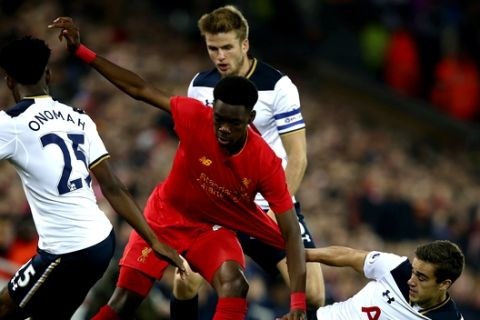 Liverpool's Oviemuno Ejaria, centre, is surrounded by Tottenham Hotspur's Joshua Onomah, Eric Dier and Harry Winks, left - right, during the English League Cup soccer match between Liverpool and Tottenham Hotspur at Anfield in Liverpool,  England, Tuesday, Oct. 25, 2016.(AP Photo/Dave Thompson)