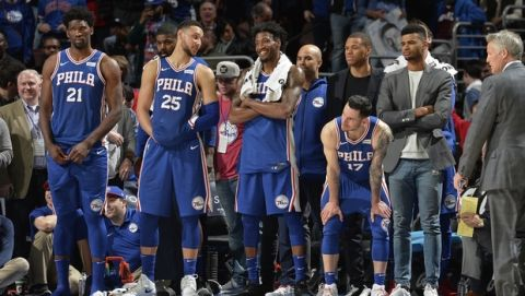 PHILADELPHIA, PA -  MARCH 26:  Joel Embiid #21, JJ Redick #17, Ben Simmons #25 and Robert Covington #33 of the Philadelphia 76ers celebrate from the bench during the game against the Denver Nuggets on March 26, 2018 in Philadelphia, Pennsylvania. NOTE TO USER: User expressly acknowledges and agrees that, by downloading and/or using this Photograph, user is consenting to the terms and conditions of the Getty Images License Agreement. Mandatory Copyright Notice: Copyright 2018 NBAE (Photo by David Dow/NBAE via Getty Images)