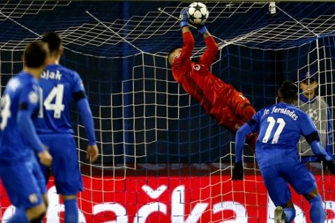 Lyon's goalkeeper Anthony Lopes makes a safe during the Champions League group H soccer match between Dinamo Zagreb and Olympique Lyonnais at Maksimir stadium in Zagreb, Croatia, Tuesday, Nov. 22, 2016. (AP Photo/Darko Bandic)