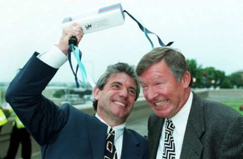 Newcastle boss Kevin Keegan cracks his Premiership rival  Manchester United manager Alex Ferguson over the head with a football rattle at Wembley as they got together to commentate for ITV on the opening England versus Switzerland game in the Euro 96 European Championships.
