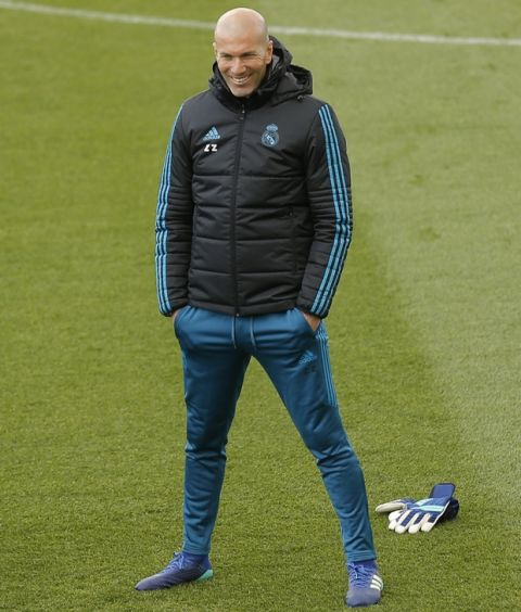 Real Madrid head coach Zinedine Zidane looks at his players during a training session at the team's Valdebebas training ground in Madrid, Monday, April 30, 2018. Real Madrid will play a Champions League semi final second leg soccer match with Bayern Munich on Tuesday, May 1. (AP Photo/Francisco Seco)