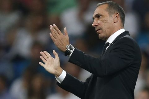 APOEL Nicosia coach Giorgos Donis reacts during a Champions League group H soccer match between Real Madrid and Apoel Nicosia at the Santiago Bernabeu stadium in Madrid, Spain, Wednesday, Sept. 13, 2017. (AP Photo/Francisco Seco)