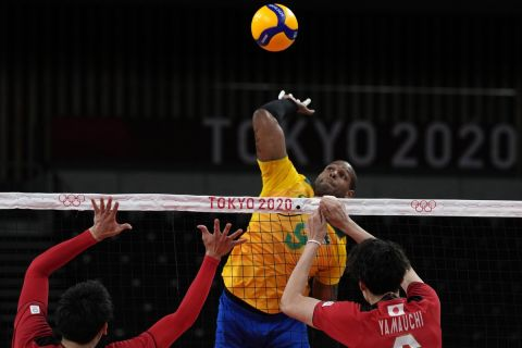 Brazil's Yoandy Leal Hidalgo jumps to hit the ball during the men's volleyball quarterfinal match between Japan and Brazil at the 2020 Summer Olympics, Tuesday, Aug. 3, 2021, in Tokyo, Japan. (AP Photo/Frank Augstein)