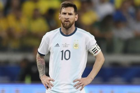 Argentina's Lionel Messi stands in the field during a Copa America semifinal soccer match against Brazil at the Mineirao stadium in Belo Horizonte, Brazil, Tuesday, July 2, 2019. (AP Photo/Ricardo Mazalan)
