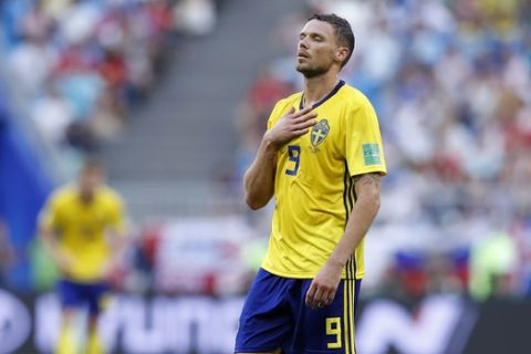 Sweden's Marcus Berg reacts after missing a scoring chance during the quarterfinal match between Sweden and England at the 2018 soccer World Cup in the Samara Arena, in Samara, Russia, Saturday, July 7, 2018. (AP Photo/Alastair Grant)