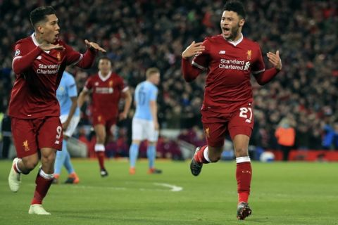 Liverpool's Alex Oxlade-Chamberlain, right, celebrates after scoring his side's second goal of the game during the Champions League quarter final, first leg soccer match between Liverpool and Manchester City at Anfield, Liverpool, England, Wednesday, April 4, 2018. (Peter Byrne/PA via AP)