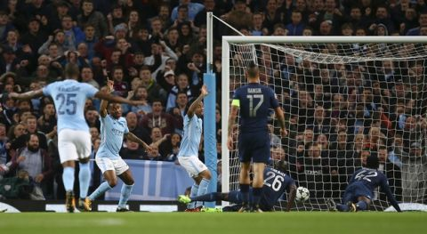 Manchester City's Raheem Sterling, second from left, celebrates after scoring during the Champions League group F soccer match between Manchester City and Napoli at the Etihad Stadium in Manchester, England, Tuesday, Oct.17, 2017. (AP Photo/Dave Thompson)