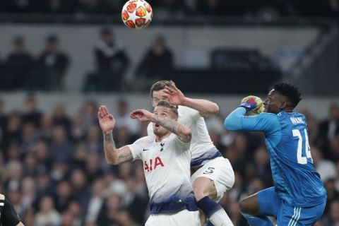 Tottenham's Toby Alderweireld, center left, and Tottenham's Jan Vertonghen, center rear, and Ajax goalkeeper Andre Onana, right, jump for the ball during the Champions League semifinal first leg soccer match between Tottenham Hotspur and Ajax at the Tottenham Hotspur stadium in London, Tuesday, April 30, 2019. (AP Photo/Frank Augstein)