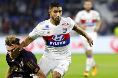 Lyon's Nabil Fekir, right, challenges for the ball with Dijon's Benjamin Jeannot, left during their French League One soccer match in Decines, near Lyon, central France, Saturday, Sept. 23, 2017. (AP Photo/Laurent Cipriani)