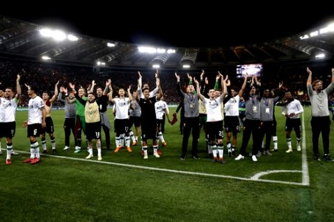 Liverpool coach Jurgen Klopp, right, and players celebrate at the end of the Champions League semifinal second leg soccer match between Roma and Liverpool at the Olympic Stadium in Rome, Wednesday, May 2, 2018. (AP Photo/Alessandra Tarantino)