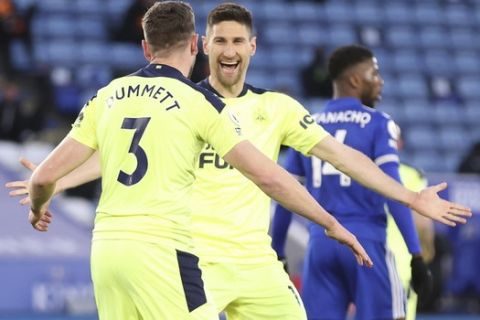 Newcastle's Paul Dummett, left, celebrates after scoring his side's second goal during the English Premier League soccer match between Leicester City and Newcastle United at the King Power Stadium in Leicester, England, Friday, May 7, 2021. (Alex Pantling/Pool via AP)