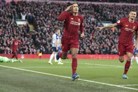 Liverpool's Virgil van Dijk celebrates after scoring during the English Premier League soccer match between Liverpool and Brighton at Anfield Stadium, Liverpool, England, Saturday, Nov. 30, 2019. (AP Photo/Jon Super)