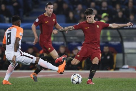 Roma's Diego Perotti kicks the ball as Shakhtar's Fred challenges him, during a Champions League round of 16 second-leg soccer match between Roma and Shakhtar Donetsk, at the Rome Olympic stadium, Tuesday, March 13, 2018. (AP Photo/Gregorio Borgia)