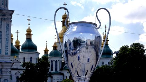 A huge replica of the Champions League trophy is placed in front of St. Sophia Cathedral, in Kiev, Ukraine, Wednesday, May 23, 2018. Liverpool will play Real Madrid in the Champions League Final on May 26 at the Olympiyski stadium in Kiev. (AP Photo/Efrem Lukatsky)