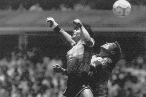 FILE - In this June 22, 1986 file photo  Argentina's Diego Maradona, left, beats England goalkeeper Peter Shilton to a high ball and scores his first of two goals in a World Cup quarterfinal soccer match, in Mexico City. On this day: This was the day of the Hand of God, when Maradona used his left fist to knock a ball past England's Shilton. (AP Photo/El Grafico, Buenos Aires, File)