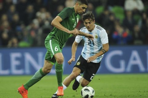 Argentina's Paulo Dybala, right, challenges for the ball with Nigeria's Leon Balogun during the international friendly soccer match between Argentina and Nigeria in Krasnodar, Russia, Tuesday, Nov. 14, 2017. (AP Photo/Sergey Pivovarov)