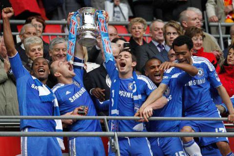 Chelsea's Ivorian striker Didier Drogba (L), captain John Terry (2nd L) and midfielder Frank Lampard (3rd L) lift the cup after Chelsea's 2-1 win in the FA Cup final football match between Liverpool and Chelsea at Wembley Stadium in London, England on May 5, 2012. AFP PHOTO/IAN KINGTON                                                                                                               NOT FOR MARKETING OR ADVERTISING USE / RESTRICTED TO EDITORIAL USEIAN KINGTON/AFP/GettyImages