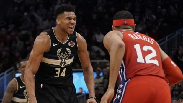Milwaukee Bucks' Giannis Antetokounmpo reacts after a dunk during the second half of an NBA basketball game against the Philadelphia 76ers Thursday, Feb. 6, 2020, in Milwaukee. The Bucks won 112-101. (AP Photo/Morry Gash)