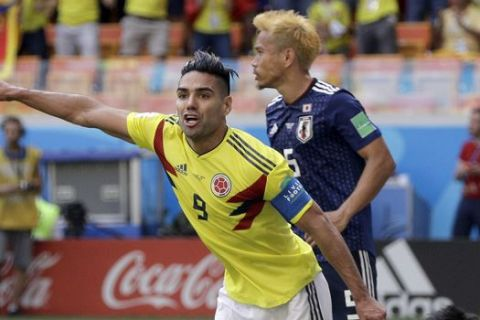 Colombia's Radamel Falcao, front gestures after Colombia's Juan Quintero scored his side's first goal during the group H match between Colombia and Japan at the 2018 soccer World Cup in the Mordavia Arena in Saransk, Russia, Tuesday, June 19, 2018. (AP Photo/Mark Baker)